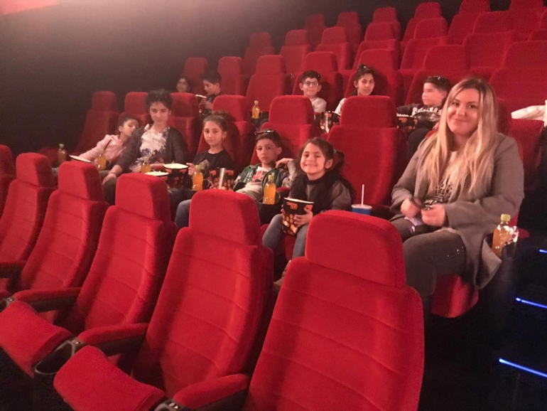 With children at the Cinema